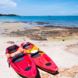 Kayaks on the tropical beach — Stock Photo