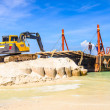 Stock Photo: Bulldozer working on a beach