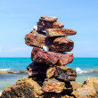 Stock Photo: Balancing of pebbles each other on seacoast