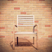 Bench against a brick wall — Stock Photo