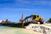 Bulldozer working on a beach — Stock Photo