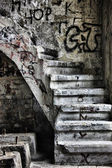 Abandoned staircase in ran down building — Stock Photo