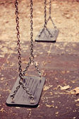 Abandoned swings — Foto Stock