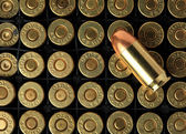 Cartridges of .45 ACP pistols ammo. — Stock Photo