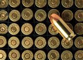 Cartridges of .45 ACP pistols ammo. — Stock Photo