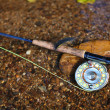 Fly fishing tackle in stream — Stock Photo