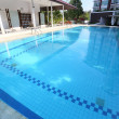 Swimming pool with residence — Foto de stock #25317335