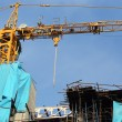 Stock Photo: Crane and construction site