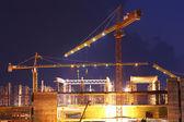 Crane and construction site twilgiht — Stock Photo