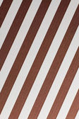 Brown and white diagonal stripes — Stockfoto