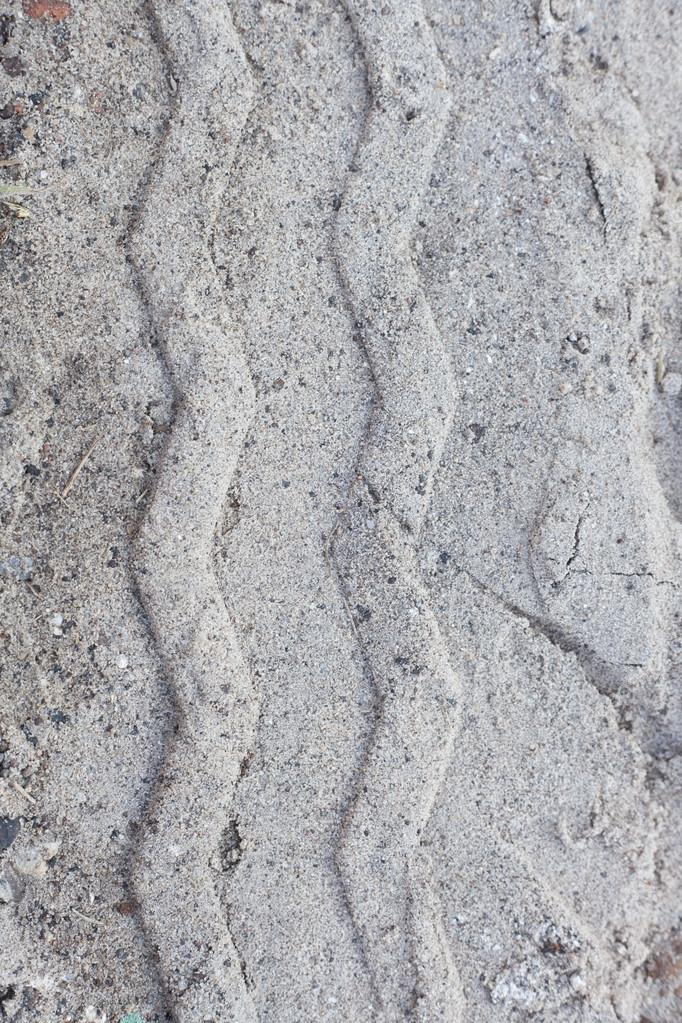 Close-up of a tire track at the beach — Stock Photo #12967508
