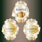 Set of white ornate labels with Gold Tapes. — Stock Vector
