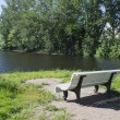 Bench on the lakeside — Stock Photo