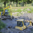 Stock Photo: Bulldozer stuck in mud