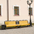 Bench under lamp in city park — Stock Photo