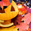 Foto de Stock  : Pumpkin halloween and autumn leaves