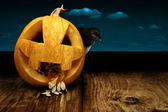 Collage pumpkin and crow — Foto de Stock