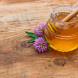 Honey and flowers — Stock Photo