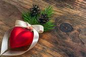 Christmas ball with a ribbon heart — Stock Photo