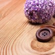 Old wooden buttons on the boards — Stock Photo