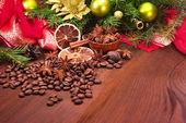 Spices and Christmas tree with decorations — Stock Photo