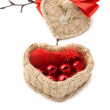 Basket in the shape of hearts with red beads — Stock Photo #36478087