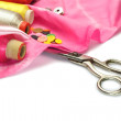 Stock Photo: Scissors and thread with buttons