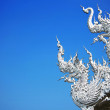 Art architecture of Wat rong khun temple in thailand — Stock Photo #17977491