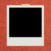 Instant photo frame on racetrack background — 图库照片