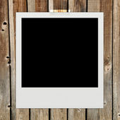 Instant photo on wood pattern background — Stock Photo