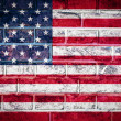 Photo: Collection of North Americflag on old brick wall texture
