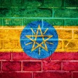 Photo: Collection of africflag on old brick wall texture background