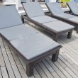 Relax chair at swimming-pool in a hotel — Stockfoto