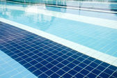 Background made of a close-up of pool water — Stock Photo