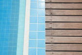 Wood pattern and swimming pool background — Stock Photo