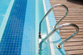 Swimming pool with stair at hotel — Stock Photo