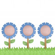 Paper craft flower on grass field on white background — Stock Photo #36981137