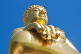 Big golden buddha statue with blue sky at Golden Triangle — Stock Photo