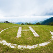 Helicopter landing pad on grass — Foto de Stock