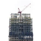 Crane at construction site — Stock Photo
