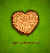 Wooden heart on green background — Stock Vector