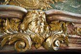 Detail of the fireplace in the Hercules Salon (or the Hercules Drawing Room) at the famous palace of Versailles, France — Stock Photo