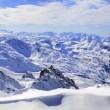 Panorama of Snow Mountain Range Landscape with Blue Sky from 3 Valleys in french Alps - Stock Photo
