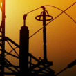 High voltage electrical tower at sunset timelapse. - Stock Photo