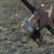 Beautiful reel reeling reel line, Surf casting. — Stock video #13866235
