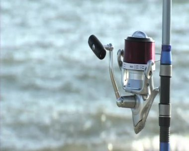 Reel with sea in background. Fishing and Surf casting. — Stock Video