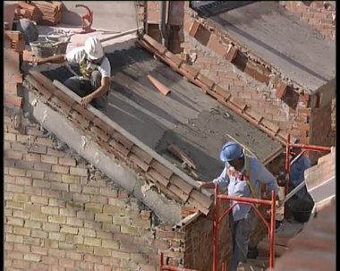 Bricklayers working in a roof of a house under construction. — Stock Video