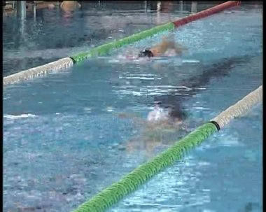 Swimmer swimming in indoor pool. — Stock Video
