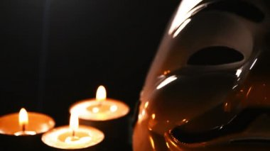 Anonymous, face mask V Vendetta with candles. — Stock Video