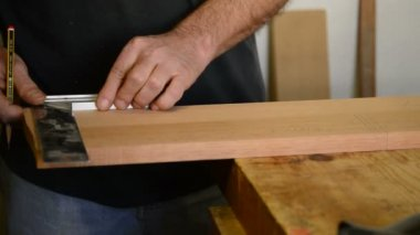 Carpenter, luthier or craftsman mark out in a table wood — Stock Video